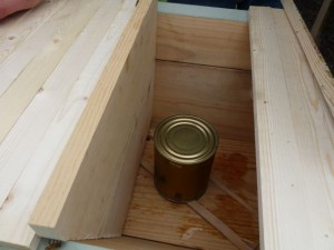 The feeding can from the package installed in the hive